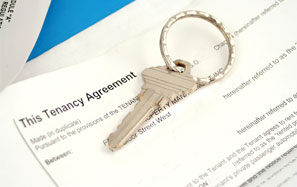 image of tenancy agreement papers and a house key