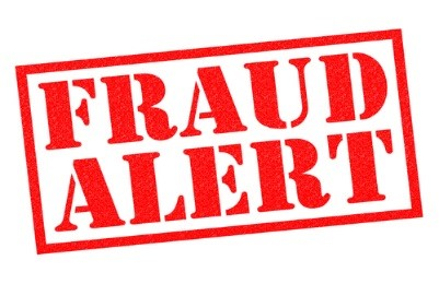 A stamp that reads: Fraud Alert